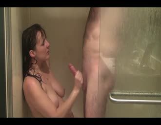 companion slurping and rubbing cock under the shower