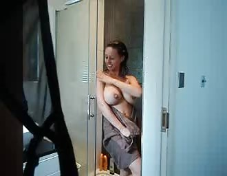 Busty chick showering and masturbating